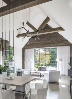 neutral white living room decor with ceiling beams, neutral dining room decor with white upholstered chairs and farmhouse dining room table Modern Farmhouse Living Room Decor, Modern Farmhouse Design, Farmhouse Interior, Living Room Modern, Modern House Design, Modern Rustic, Farmhouse Architecture, Rustic Wood, Farmhouse Style