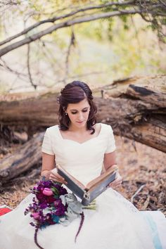 Modest wedding dress with half sleeves.  Image by Alixann Loosle