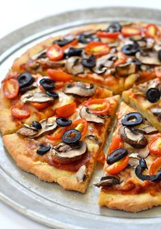 This recipe for a gluten free vegan pizza dough makes for the perfect thin…