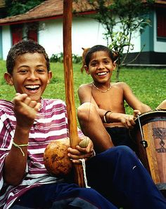 Smiles in tune with Afro-brazilian drumbeat and the hypnotic sounds of the Capoeira Berimbau