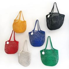 Make a statement at the beach or even at your local market with our unique net bag! Made from 100% cotton rope, our net bags are durable and expand as more goods are placed in the bag.   Mia Mélange bags are made from 100% cotton rope which we carefully sew together in a coiling technique. The cotton is grown locally in South Africa by farmers who are members of the Better Cotton Initiate (BCI). Net Bag, Cotton Rope, South Africa, Sewing, Farmers, Beach, Unique, Red, Products