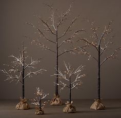 RH's Flocked Winter Wonderland Tree Collection:Cultivate a winter forest with trees that lend a magical glow to indoor and outdoor settings. The branches, wrapped in birch or dusted in snow and warm-white lights, look elegant on their own or can be strewn with garlands and ornaments. Each tree features both an on/off switch and built-in 24-hour timer.