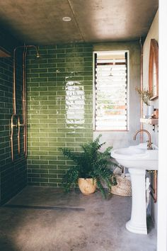 Green is having an interiors moment right now! Here the owners of paired glazed green subway tiles, copper pipes… Spa Design, House Design, Bath Design, Green Subway Tile, Green Tiles, Green Bathroom Tiles, Bathroom Subway Tiles, Green Bathrooms, Tiled Bathrooms