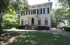 Lovingly maintained brick 1871 Italianate Victorian home. Circle drive leads to entrance. Front of home has arched first floor windows; segmented arches on second floor. Double set of entry doors 13 feet tall with original hardware. Parquet floor between entry doors. Entry hall 38ft long. ...