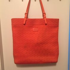 Michael Kors Tote Michael Kors Orange Tote Used a few times. Overall good condition but there is a small burn mark (see photo 2). Not very visible.  Bought for $275. Michael Kors Bags Totes