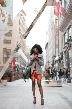 black model with pink glasses, orange silk short romper, grey jacket coat and black strappy high heel sandals #stealthestyle Black Strappy High Heels, New Makeup Trends, What's Your Style, Free Wedding, Wedding Ideas, Silk Shorts, Basic Outfits, Bubblegum Pink, Black Models