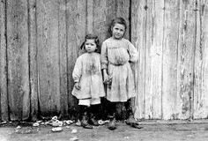 Maud Daly, five years old. Grace Daly, three years old.     Pick shrimp at the Peerless Oyster Co., Bay St. Louis, Mississippi, 1911