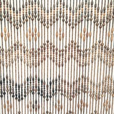 Vintage large beaded curtain or room divider. Features chunky wooden beads that are woven into a zig zag pattern. This long wood bead curtain is 72 inches long. The total width is 57 inches, which is made up of three sections from left to right - 17 inches, 24 inches and 16 inches respectively.  This hippie boho decor curtain is in good vintage condition. There is some fading on the lower parts and it looks like someone tried to spray paint the zig zag sections. Please look at the wide shot…