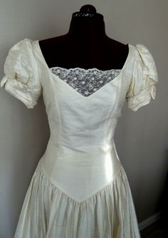 Vintage Laura Ashley Silk dress This is it!!!!! Love love love this dress! So fitting for my Tangled themed wedding