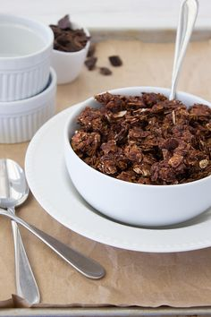 Double Chocolate, Almond, and Coconut Granola - a perfectly crunchy granola filled with chocolate-y clumps of oats, almonds, and coconut flakes, with chunks of dark chocolate in every bite. | www.brighteyedbaker.com