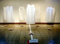 """Adela Marín Villegas ~ """"He who is blameless ... stick the first"""" (2007-2008). Dresses with adhesive labels with barcodes, which contain derogatory qualifying the Costa Rican society, """"bitch,"""" """"shallow,"""" """"unique,"""" """"pig,"""" """"stupid,"""" """"tambourine,"""" ediondo roco (applied to sex worker , homosexual, the Nicaraguan immigrant, someone with no common habits, weak, religious, dirty old respectively each word)  *""""El que esté libre de culpa… pegue la primera"""" (2007-2008). Vestidos con etiquetas…"""