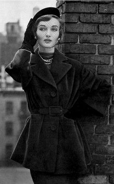 1949 Evelyn Tripp in short belted topcoat of brown Forstmann wool by Davidow