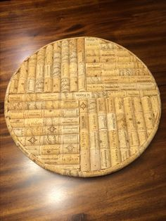 Handmade lazy Susan (it spins) made out of wine corks. Great for hot pots on the table.