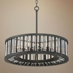 Silver finish rods bring understated luxury to this handsome drum pendant.