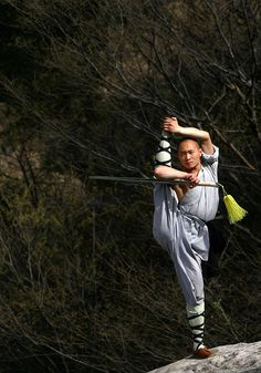 Shaolin monk demonstrating the exceptional strength, flexibility and balance the Shaolin monks are noted for