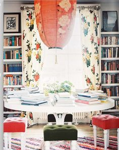 loving books all over a dining table with stools
