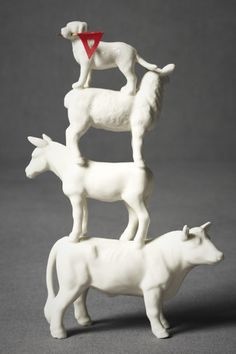 Glue a few plastic toys together and spray paint glossy white. Easy peasy, Anthropologie.