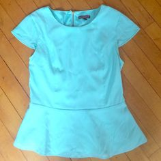 Express Mint Peplum Top with Zipper Love this top! Some weird discoloring around the neckline, likely from the material pilling or something but if you wear with a statement necklace or scarf it's not noticeable. Express Tops Blouses