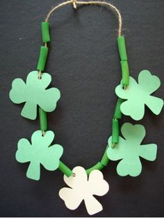Lucky Charm Necklace Wear green for St. Paper shamrocks and painted noodles fit perfectly together on a piece of string to create this lucky charm necklace. The post Lucky Charm Necklace was featured on Fun Family Crafts. March Crafts, St Patrick's Day Crafts, Daycare Crafts, Classroom Crafts, Preschool Crafts, Holiday Crafts, Kids Crafts, Kids Diy, Spring Crafts For Preschoolers