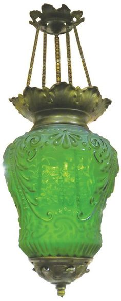 Beautiful Victorian Adjustable Hanging Lamp. Candle lit, embossed and etched green glass.