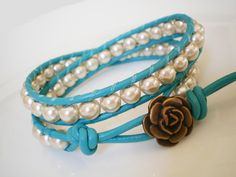 Turquoise Leather Wrap Bracelet w Champagne Faux Pearls  and Rose Button. $24.00, via Etsy.