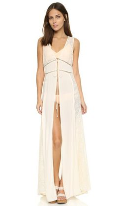 Crinkled crepe and patterned lace lend an eclectic feel to this airy L*Space cover-up robe. A self-sash and hook-and-eye closure secure the placket. Sleeveless.