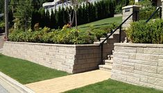 Sometimes regarded as a retaining wall, a block wall is mostly used to create a structure for a higher-ground garden. A block wall needs a good structure Retaining Wall Steps, Retaining Wall Design, Garden Retaining Wall, Outside Stairs, Garden Blocks, Sloped Yard, Exterior Stairs, Front Steps, Block Wall