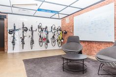 Employees receive a monthly Uber credit, andsome use the app to commute, but others prefer to cycle to work. The walls of the office are fixed with plenty of bike racks made from the building's original white ceiling tiles.