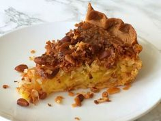 FRENCH COCONUT PIE WITH PINE NUTS: Tender coconut and toasty pine nuts baked into an egg filling perfumed with butter, vanilla, coconut and almond flavors, sparked with lemon zest. French Coconut Pie, Dessert Drinks, Desserts, Pie In The Sky, No Bake Pies, Pound Cake, Pie Dish, Love Food, Pine