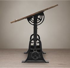 RH's 1910 American Trestle Drafting Table - cast iron topped with a broad wooden work surface that lifts, lowers and tilts to suit the worker