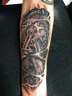 Tattoo picture tagged with Arm Biomechanical Gear Tattoo, made by Bad Apples Tattoo from Australia.