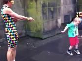 Adorable Boy Steals the Spotlight from an Awesome Street Performer... and It's SO Cute!