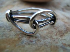 LOVE KNOT RING - Sterling Silver .... $22.00, via Etsy.