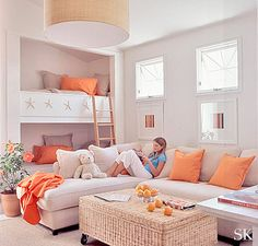 mango orange, white, and natural modern bedroom and lounge. Suzanne Kasler