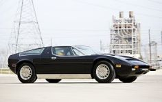 #21. 1973 Maserati Bora 4.9... 4930cc (4x Weber 42 DCNF carbs; 300bhp@6000rpm) DOHC alloy V8, plus the kind of stuff that comes on garden-variety sport cars these days (5-Speed ZF manual, 4-wheel ventilated Girling discs, all-independent suspension w/coil-over shocks...). Still, it was the *business* in the early '70s. This car, chassis no. AM117-49/US688, sold @ auction for $181.5k USD in Mar. 2015 (Gooding & Co., Amelia Island, FL {32034}).