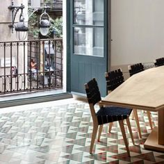 Carrer Avinyo 34 by  David Kohn Architects  n: Beautiful tilework, maybe a visual note to different zones within yard?