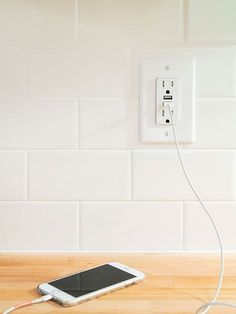 Upgrade your old outlets with ones that have built-in USB chargers.