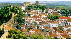 Must-see walled cities around the world   Via Fox News   27.04.2015 - Óbidos is particularly lovely in the summer, when leafy church squares abloom with wisteria and geraniums form the perfect backdrop to the ancient architecture.#Portugal
