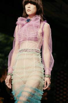 Seen on the runway, a Gucci Spring Summer 2016 tulle organdy gown with trompe l'oeil details by Alessandro Michele.