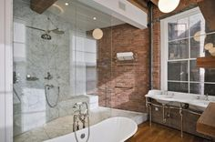 Jane Kim Design- Urban loft bathroom with red brick accent wall and large window. Industrial Bathroom Design, Eclectic Bathroom, Bathroom Styling, Brick Design, Industrial Style Bathroom, Industrial Bathroom, Brick Bathroom, Urban Loft, Bathroom Design