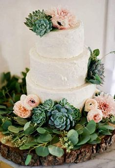 he Prettiest Floral Wedding Cakes. Three-tiered wedding cake with ranunculus, anemones, and succulents, The Butter End. See more bohemian wedding cakes. Succulent Wedding Cakes, Floral Wedding Cakes, Wedding Cakes With Flowers, Spring Wedding Cakes, Cake Flowers, Floral Cake, Bohemian Wedding Cakes, Fresh Flowers, Bohemian Cake