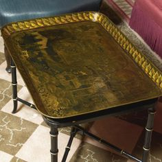 A Regency black-japanned and parcel-gilt tôle peinte tray on later stand