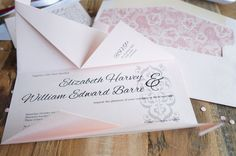 Aijou - origami-inspired wedding invitation by A Tactile Perception. Pink paper stock with delicate filigree design