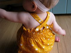 The ever-popular Baby Sunsuit Tutorial ** I couldn't let yet ANOTHER summer go by without updating this oldie-but-goodie tutorial! I hope you'll enjoy this sunsuit tutorial, new and improved! **This is an update to the. Love Sewing, Sewing For Kids, Baby Sewing, Diy For Kids, Sewing Projects For Beginners, Sewing Tutorials, Sewing Hacks, Sewing Tips, Sewing Ideas
