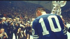 The Maple Leafs' George Armstrong holds the Stanley Cup on May 1967 at Maple Leaf Gardens in Toronto. Hockey Teams, Hockey Players, George Armstrong, Vancouver Canucks, National Hockey League, Toronto Maple Leafs, Stanley Cup, A Team, Nhl
