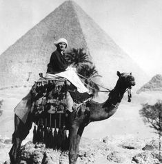 Ballerina Anna Pavlova riding a camel in Egypt, 1923