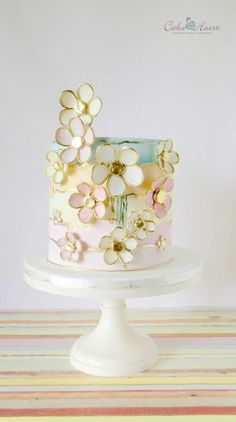 Cheery gold-rimmed daisies and pastel hues make this cake one of the happiest, a… Gorgeous Cakes, Pretty Cakes, Amazing Cakes, Fondant Cakes, Cupcake Cakes, Watercolor Cake, Gateaux Cake, Painted Cakes, Dream Cake