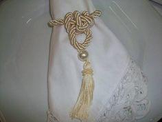 cconfeccionado em cordao,perola e pingente de seda..... R$ 4,95