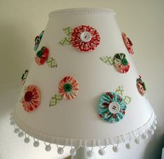 Yo-yo Flowers Lampshade by Richele Nadine by design, via Flickr