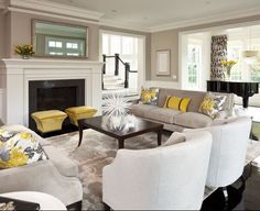 Neutral sofa and chairs with pop of color from pillows, flowers and ottomans.